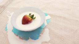 strawberry fall into cream Footage