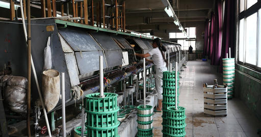 4k Machine Producing Tissues In A Silk Factory,Spinning Machine Collect silk Live Action
