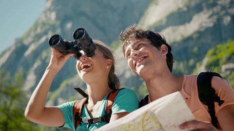 Boyfriend And Girlfriend With Map And Binoculars D stock footage