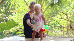 little blonde girl play with her mother Footage