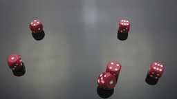 red dice cast on black Footage