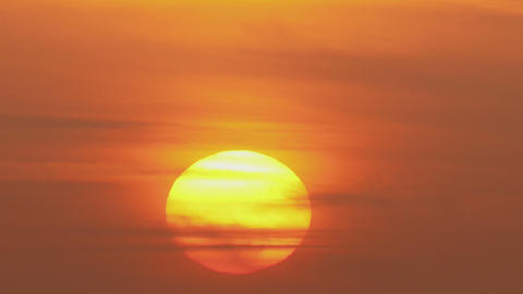 Great Sun Rising Close Up Between The Clouds - Tim stock footage