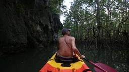 Man Boating In Kayak Along Lagoon stock footage