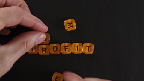 Letter Blocks Spelling More Profit Footage