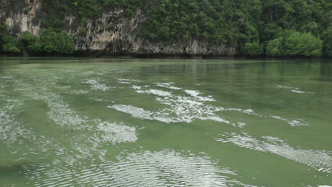 ripples running transparent water in lagoon rocky  Footage