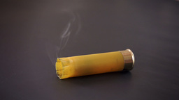 Shotgun Shell Falling And Smoking stock footage