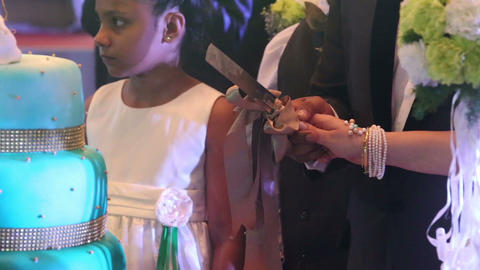 indian child look how bride and groom cut wedding  Footage