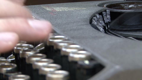 Hand On A Typewriter Keyboard stock footage