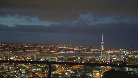 2 angles - Aerial of city and Auckland patio Night Live Action