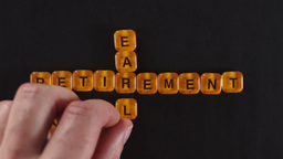 Letter Blocks Spell Early Retirement stock footage