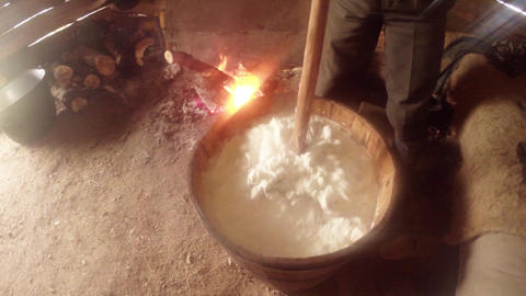 frothed milk timber pressure in a wooden barrel on Footage
