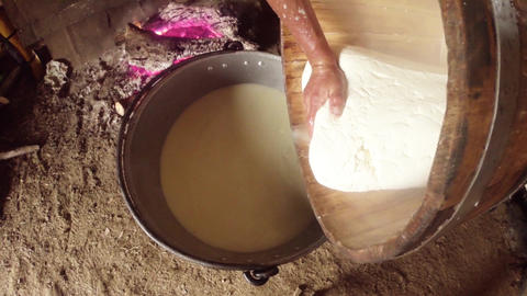 hand presses the sheep cheese in a wooden tub on t Footage