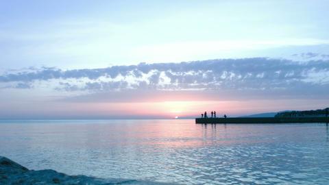 Sunset. Sea. People Footage