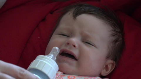 Milk On Baby's Face With Curl stock footage