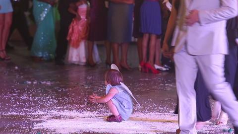 little child wearing butterfly wings play at weddi Footage