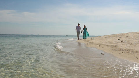 couple of blonde girl and guy walk barefoot along  Footage