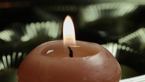 1080p Ungraded: Candle Close-Up on Shiny Background Footage