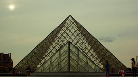 Tourists walk in front of the Louvre in Paris, Fra Live Action