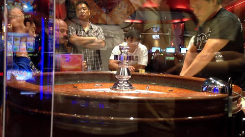 People playing roulette in casino, shot behide gla Footage