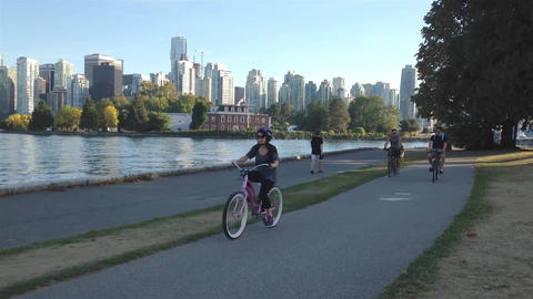 People riding bicycle and strolling in the Stanley Footage
