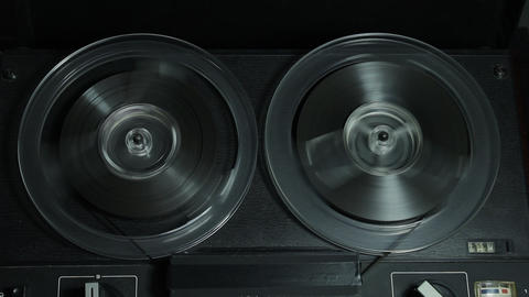 1080p Ungraded: Reel-To-Reel Tape Recorder Rewinds Tape Footage