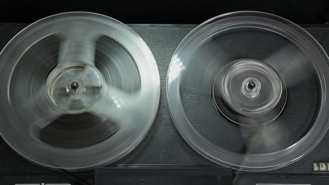 1080p Ungraded: Reel-To-Reel Tape Recorder Rewinding Tape Footage