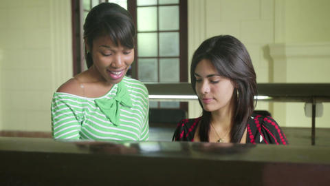 Female Students Studying Together At School Footage