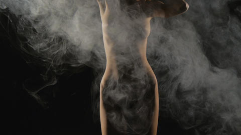 Young girl posing nude, naked in smoke, slow-motio Footage
