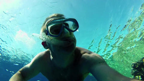 Man Swimming And Snorkeling Near Coral Reef In Red GIF