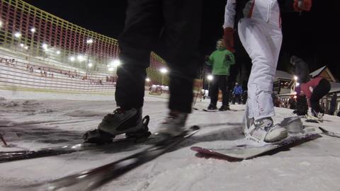 Skis, ski boots, legs Footage