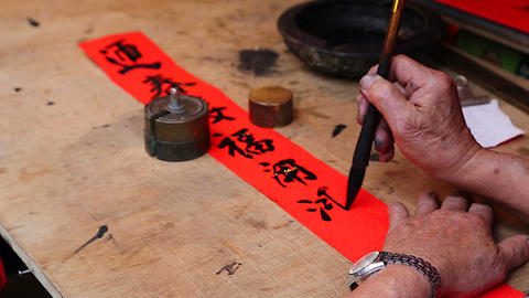 Man Writing Chinese At Chinese New Year Market - C stock footage