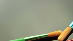 Colorful Paintbrush On Black Tracking stock footage