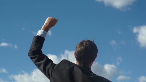 Male Businessman Back Raising Victory Arm GIF
