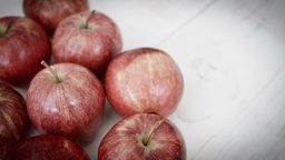 Red Apple Against A Rustic White Background HD Stock Footage stock footage