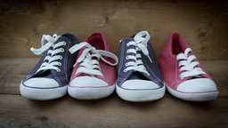 Two pairs of blue and red leisure shoes HD stock footage Footage