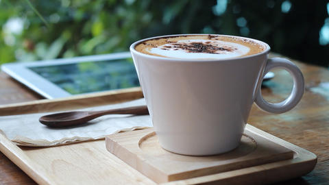 Putting Sugar In Cappuccino stock footage
