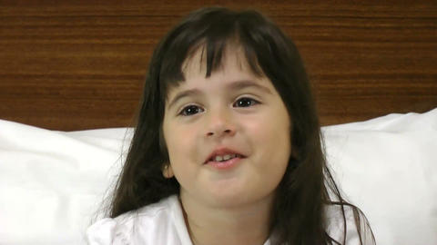 Close up of happy little girl in bedroom Footage