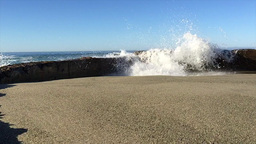 crashing wave over seawall Footage