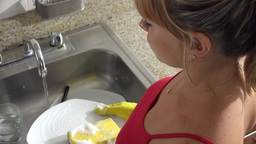 Woman Doing Chores And Washing Dishes At Home Footage