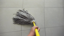 Woman Doing Chores Washing Floor At Home Footage