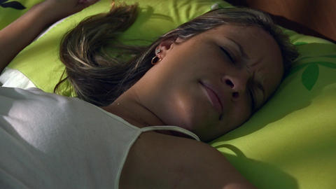 Young Woman In Bed Waking Up At Morning Snoozing A Footage