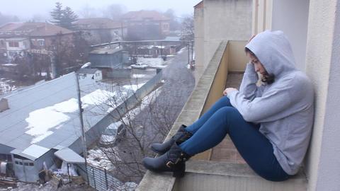 Sad Young Girl Sitting On Wall stock footage