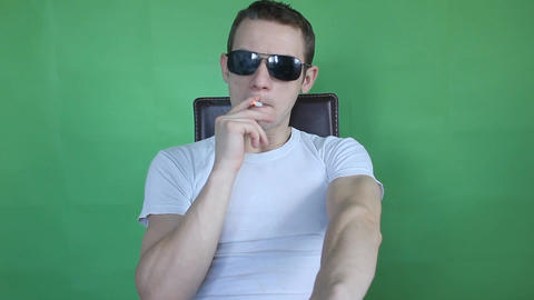 Young Man Smoking Green Screen stock footage