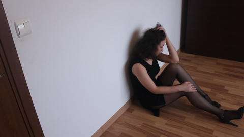 Young Triste Girl In The Room , Triste Sitting Dow stock footage