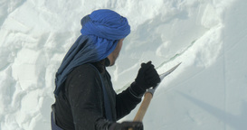 Snow Sculpture Man Carving 03 stock footage