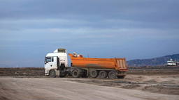 Running dump truck and horn noise at construction  Footage