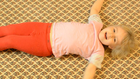 Happy Child Lying on a Carpet, Crazy Emotions Footage