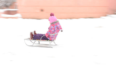 Child Sledding On Hill, Kid Playing, Sledging In Park In Winter stock footage