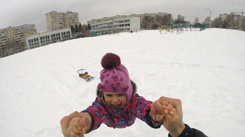 Happy Child Rotates in Winter Day, Slow Motion Footage