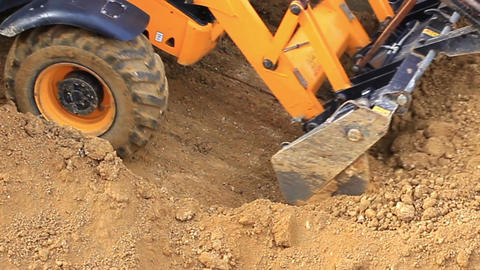 Rubber tired backhoe excavator loader works for formation of land for the housin Footage